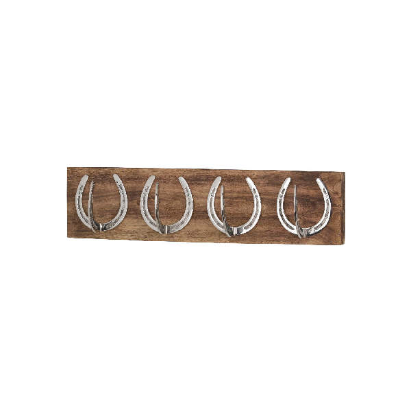 Four Nickel Horse Shoe Hooks On Wooden Board